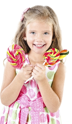 Happy little girl with lollipop isolated