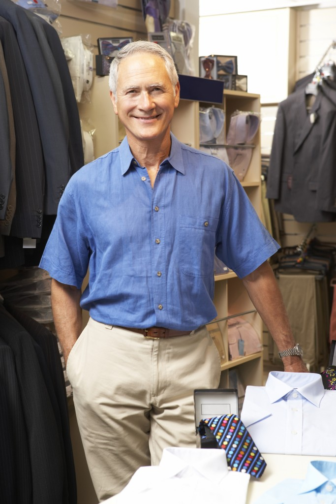 Male sales assistant in clothing store