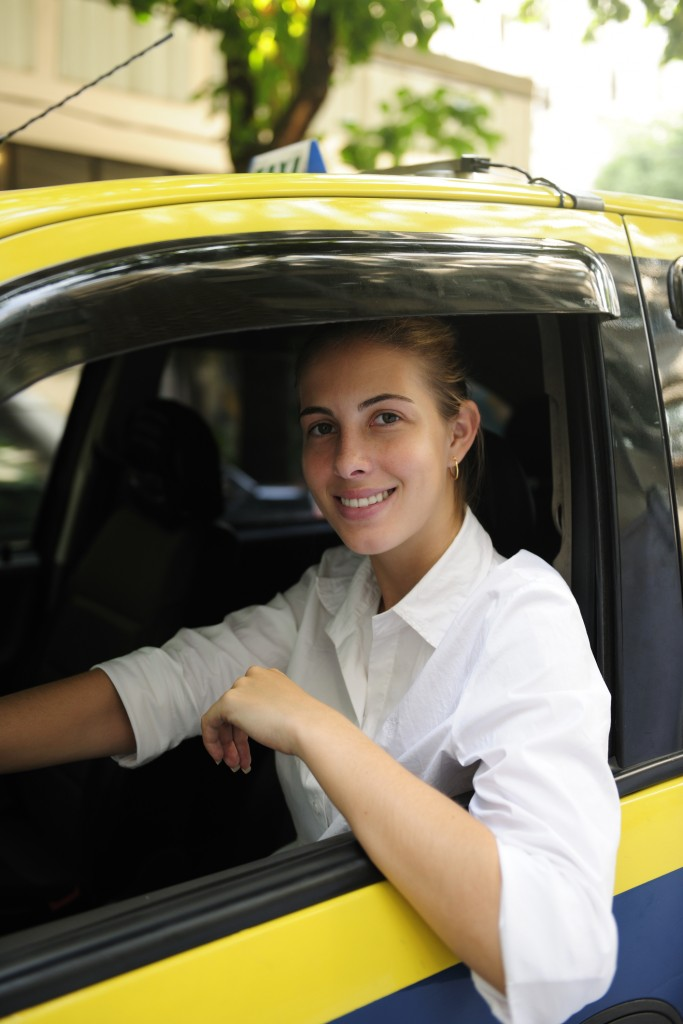 Portrait of a female taxi driver