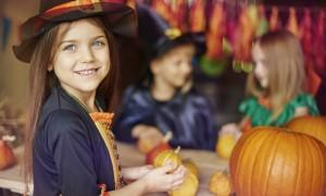 Busy children preparing Halloween decorations