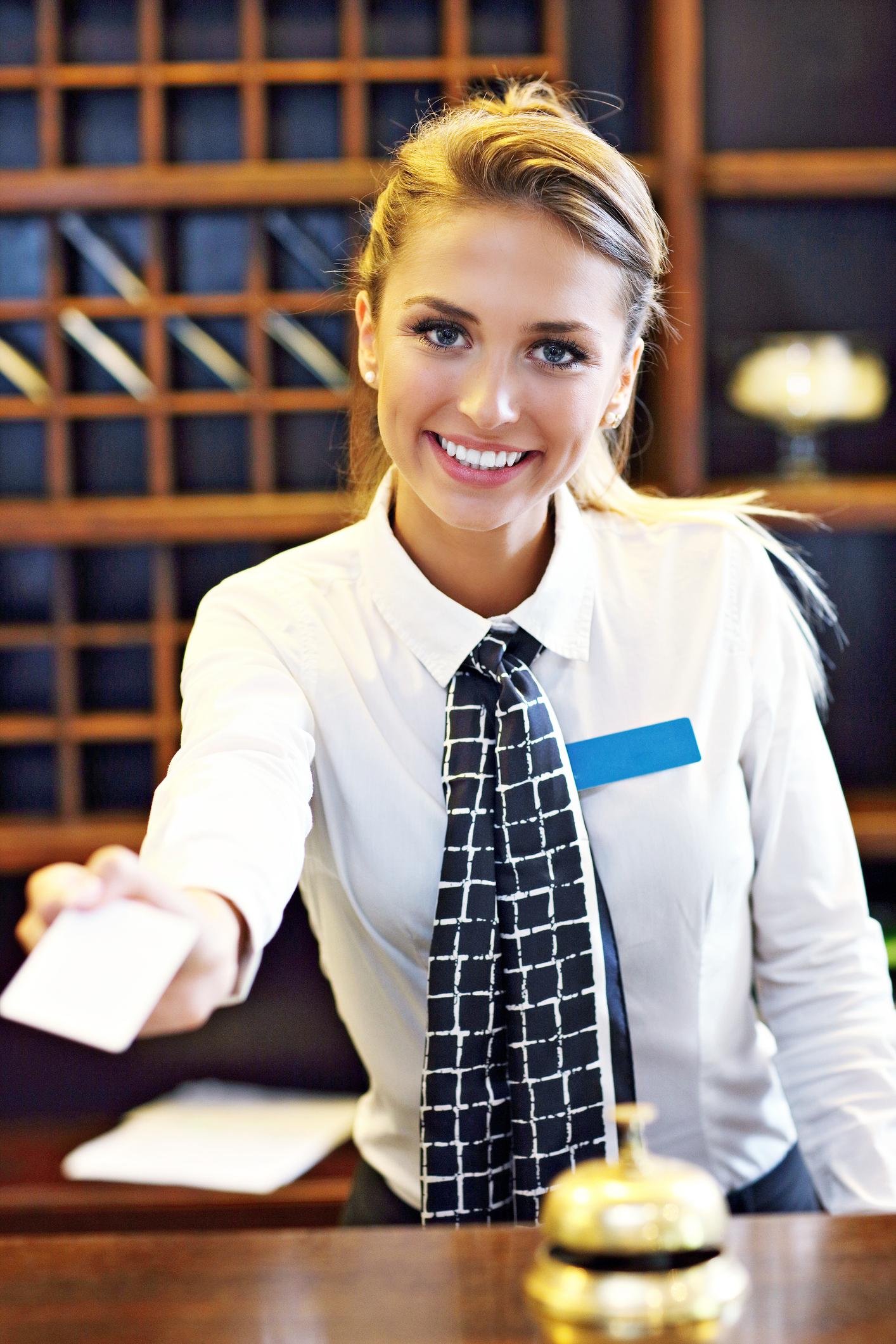Pretty receptionist giving key card