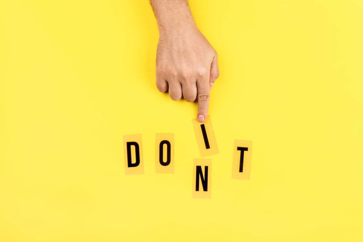 Yellow background with a male hand that changes the word don't to do it